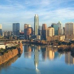 From high above Lady Bird Lake, this is a bird's eye view of the Austin, Texas, and the downtown skyilne. Below is Lady Bird Lake and also a portion of the Zilker Park Hike and Bike Trail. This aerial image was taken on a beautiful morning in central Texas.